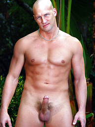 Bald hunk Christian posing outdoors