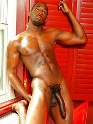 Hot ebony man strokes his huge cock